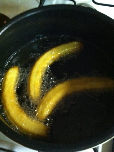 churros in a pan of oil.