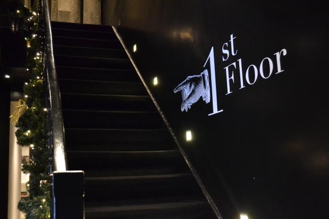 follow the black carpet stairs...